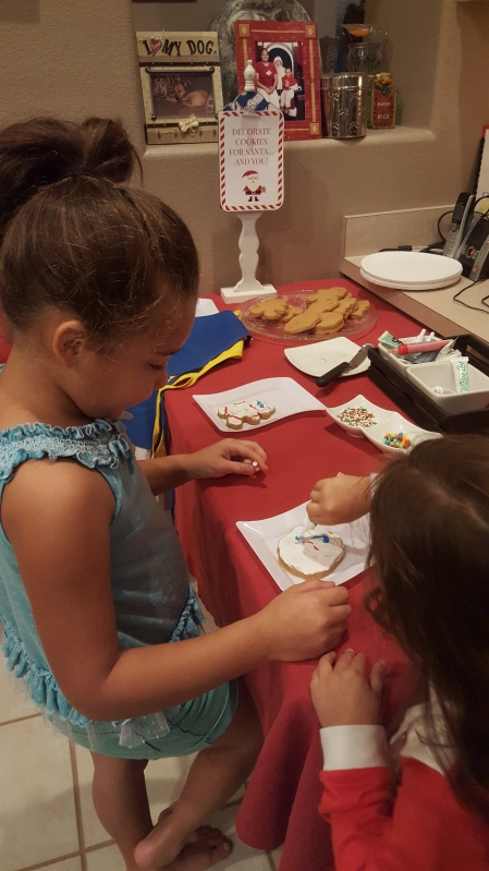 Reina helped Madelyn make her 2nd cookie.